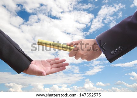 businessman send golden boton to another one with blue sky - stock photo