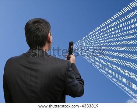 Businessman sending global code - stock photo
