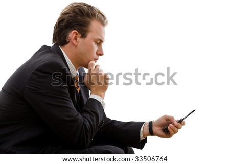 Businessman sending SMS on cellphone, isolated on white background. - stock photo