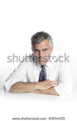 businessman senior glasses relaxed portrait white desk background - stock photo