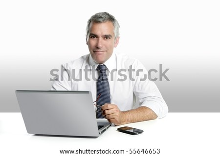 businessman senior gray hair working laptop computer white desk background - stock photo