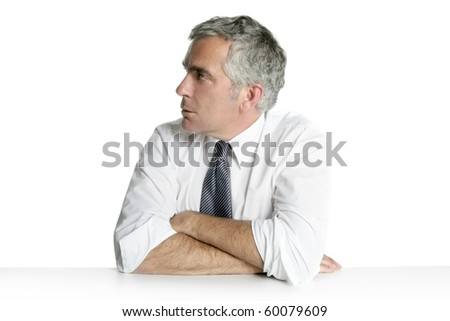 businessman senior profile relaxed sit portrait white desk background - stock photo