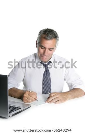 businessman senior signing bank check white desk happy gesture - stock photo