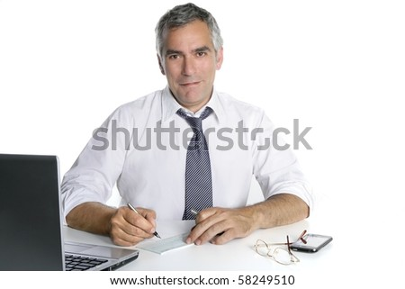 businessman senior signing bank check white desk happy gesture - stock photo