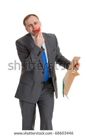 Businessman separates the red tape from his mouth - stock photo