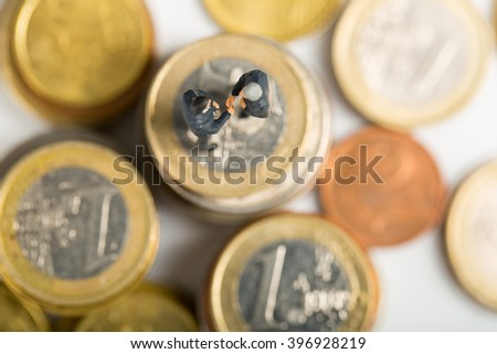 Businessman shake hands business on stack of money coin.