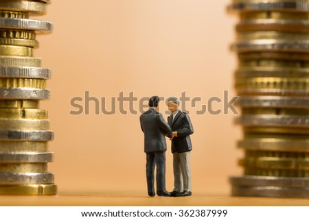 Businessman shake hands for good corporate business with chess game concept. - stock photo