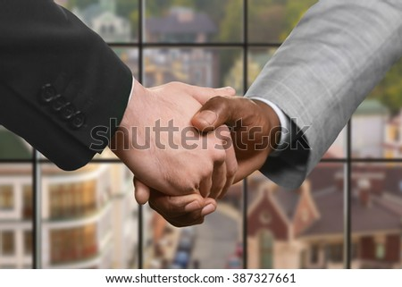 Businessman shake hands in headquarters. Business partners' handshake at daytime. Sign of mutual respect. Value the friendship.