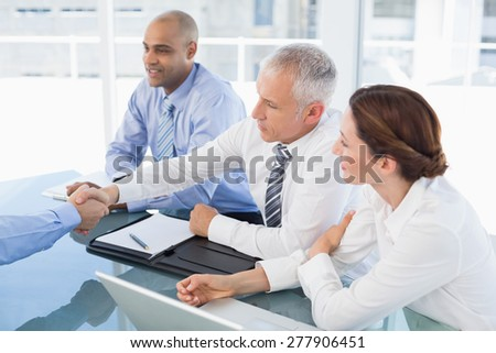 Businessman shaking hand during work interview in the office - stock photo