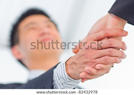 businessman shaking hands over a deal - stock photo