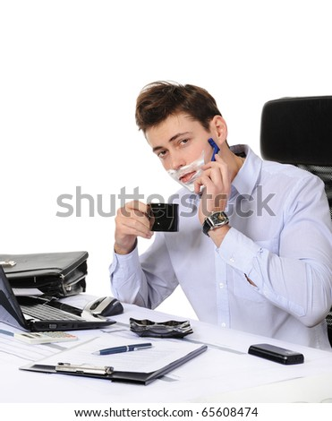 Businessman shaves in the workplace - stock photo