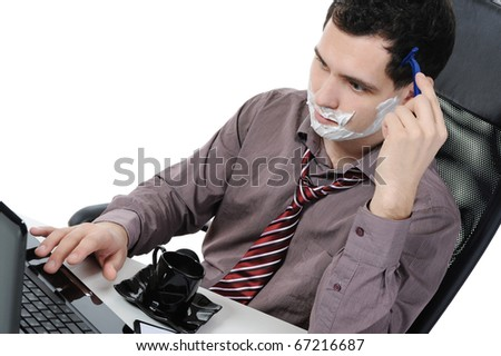 Businessman shaves in the workplace. Isolated on white background - stock photo