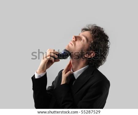 Businessman shaving - stock photo