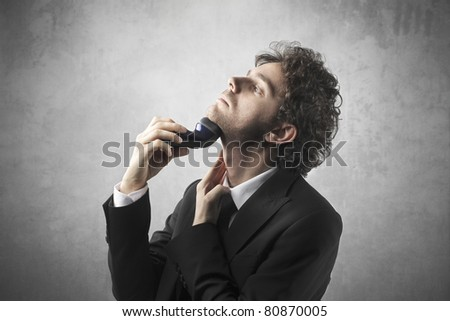 Businessman shaving - stock photo
