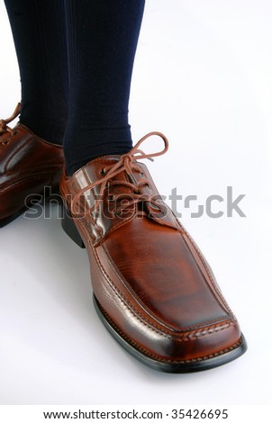 Businessman shoe on white background. Upper view, wide angle - stock photo