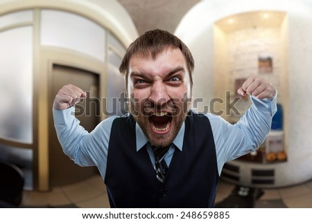 Businessman shouting at office - stock photo