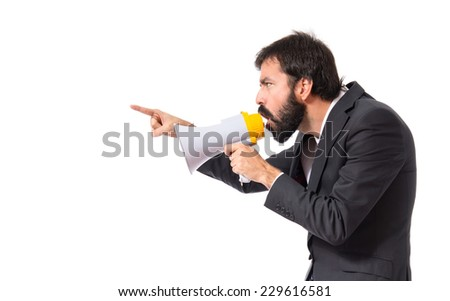 Businessman shouting by megaphone over white background - stock photo