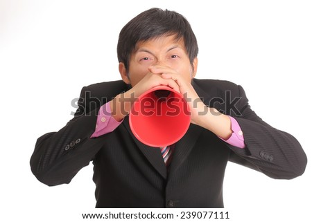 Businessman shouting for announce through a red loudspeaker  - stock photo