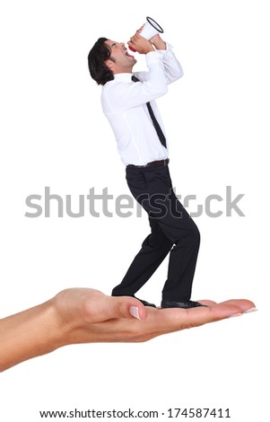 Businessman shouting into megaphone - stock photo