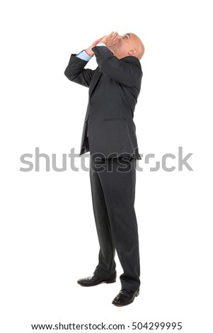 Businessman shouting isolated against a white background