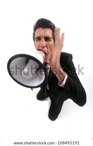 Businessman shouting through megaphone