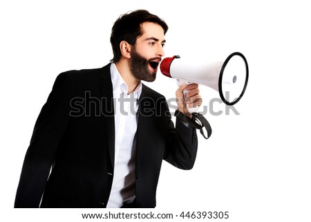 Businessman shouting using a megaphone. - stock photo