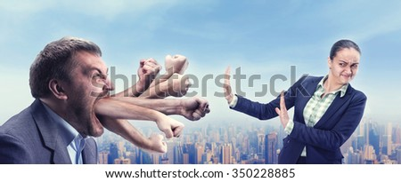 Businessman shouts at young businesswoman, many fists from his mouth - stock photo