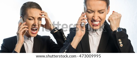 Businessman shouts on the phone