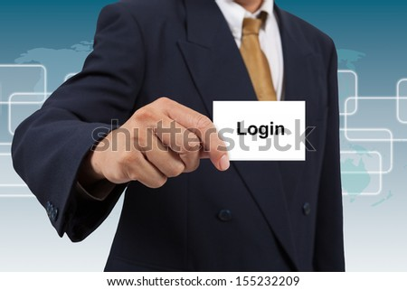 Businessman show a white card with word Login