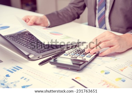 Businessman show analyzing report, business performance concept - stock photo