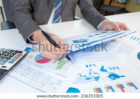 Businessman show analyzing report, business performance concept