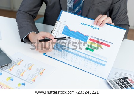 Businessman show annual report, business performance concept - stock photo
