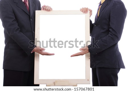 Businessman show blank board for present something