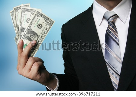 businessman show dollar banknote - stock photo