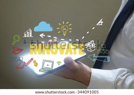 businessman show innovate concept over smart phone , business concept , business idea