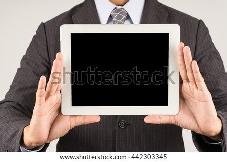 businessman show on the tablet - stock photo