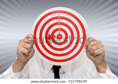 Businessman show the dart and target accuracy - stock photo