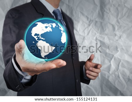 businessman  show the earth with crumpled recycle paper background as concept - stock photo