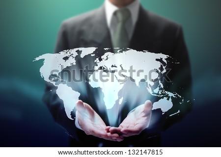 businessman show virtual world on hand. - stock photo