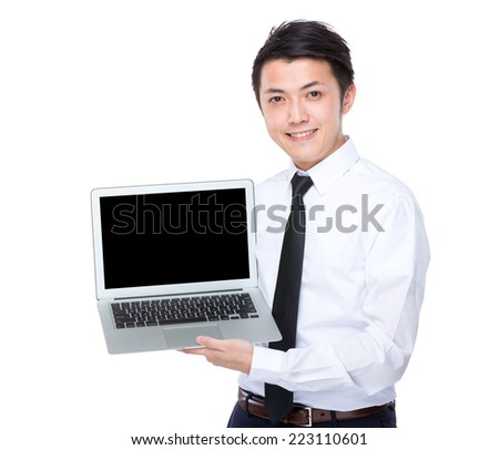 Businessman show with blank screen of laptop computer - stock photo