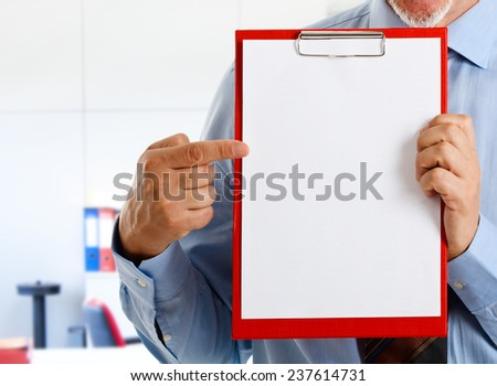 Businessman showing a blank sheet of paper - stock photo