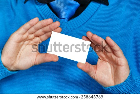 Businessman showing a business card, the person unrecognizable. Business people. The concept of attracting customers. - stock photo