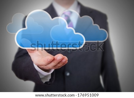 Businessman showing a Cloud - stock photo