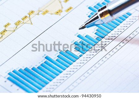 Businessman showing a diagram on a financial report using a pen - stock photo