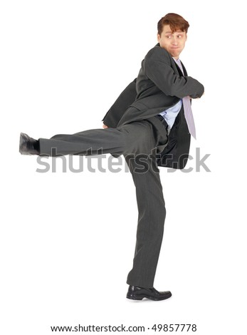 Businessman showing a karate kick, isolated on a white background