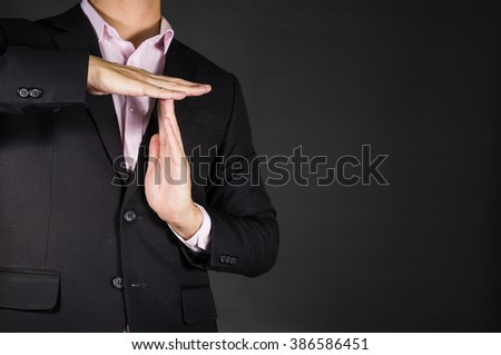 Businessman showing a pause time out gesture with hands. body language signs symbols