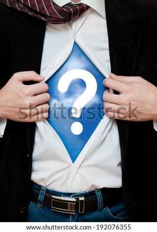 Businessman showing a question mark - stock photo