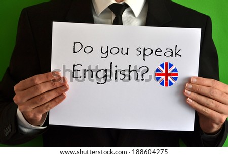 Businessman showing a sheet with text Do you speak English - stock photo