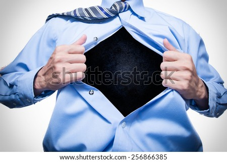 businessman showing a space in his shirt - stock photo