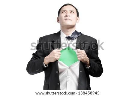 Businessman showing a superhero suit underneath his suit Super Businessman - stock photo